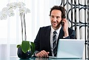 Hotel Businessman on global conference call