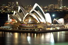 Photo of Sydney Opera House at night by Anthony Winning from Harbour Bridge.
